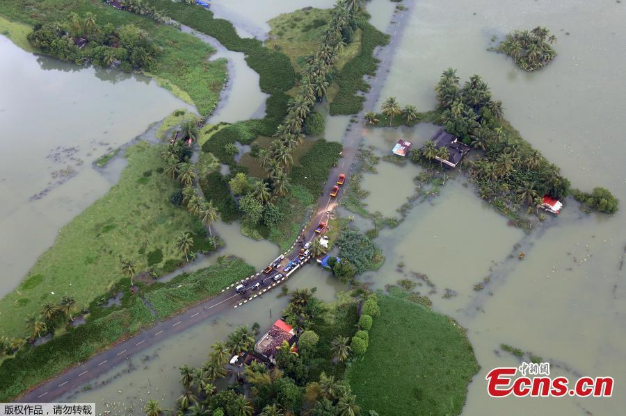 An aerial view shows partially submerged road at a flooded area in the southern state of Kerala, India, August 19, 2018. Incessant downpours since Aug. 8 have caused the worst floods in a century in the southwestern state, and close to 200 people have perished in the rising waters and landslides. (Photo/Agencies)