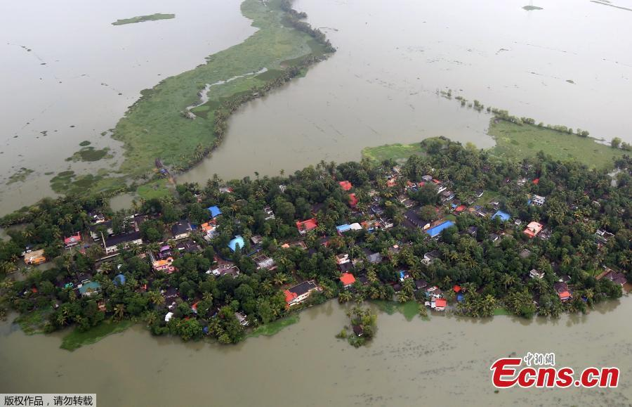 An aerial view shows partially submerged houses at a flooded area in the southern state of Kerala, August 19, 2018. Incessant downpours since Aug. 8 have caused the worst floods in a century in the southwestern state, and close to 200 people have perished in the rising waters and landslides. (Photo/Agencies)