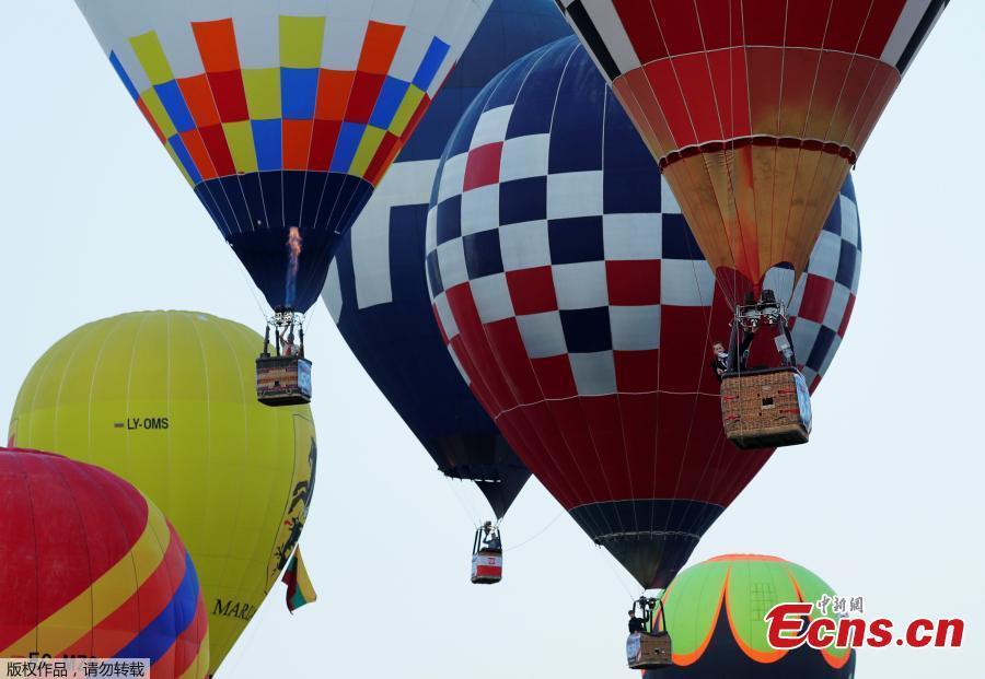 Competitors take part in the FAI World Hot Air Balloon Championship near Gross-Siegharts, Austria, August 20, 2018. (Photo/Agencies)