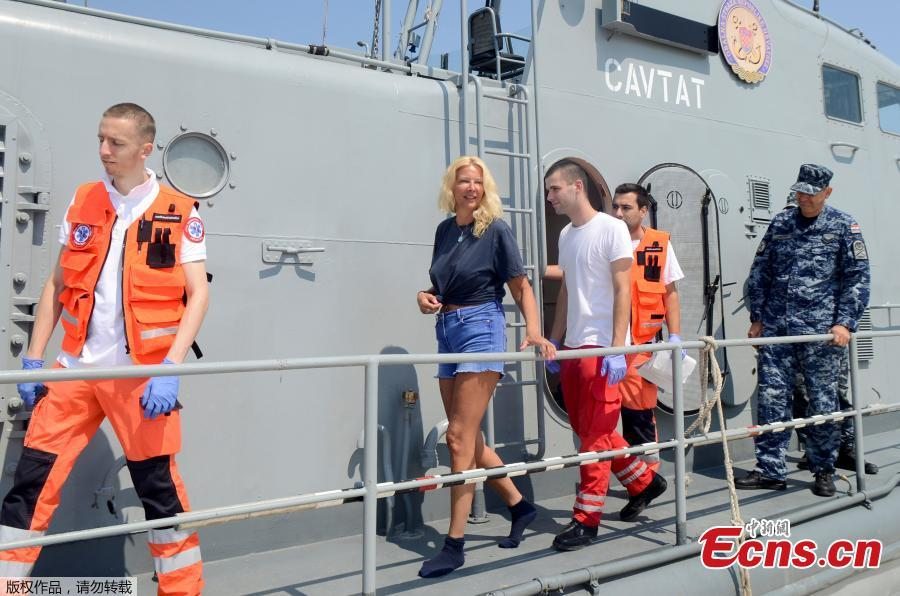 <?php echo strip_tags(addslashes(British tourist Kay Longstaff leaves the Croatian Coast Guard vessel