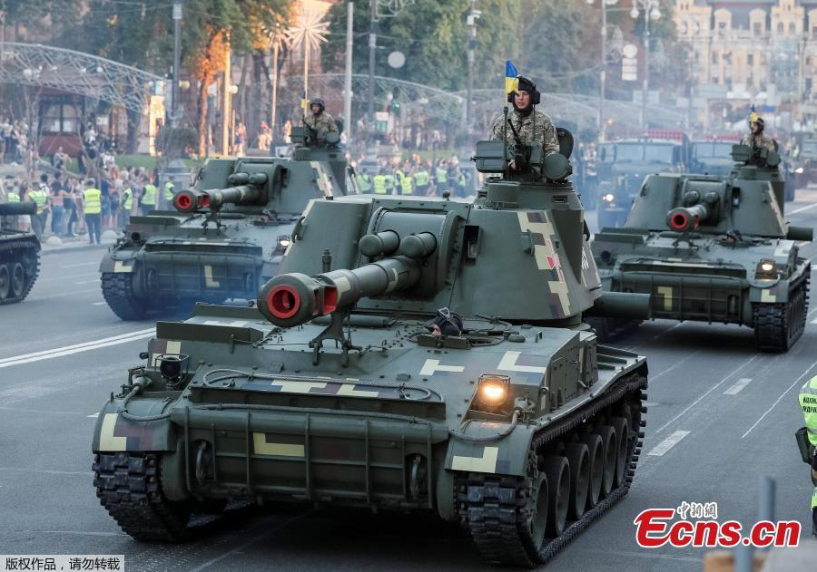 Self-propelled howitzers pass during a rehearsal for the Independence Day military parade in central Kiev, Ukraine August 20, 2018. (Photo/Agencies)