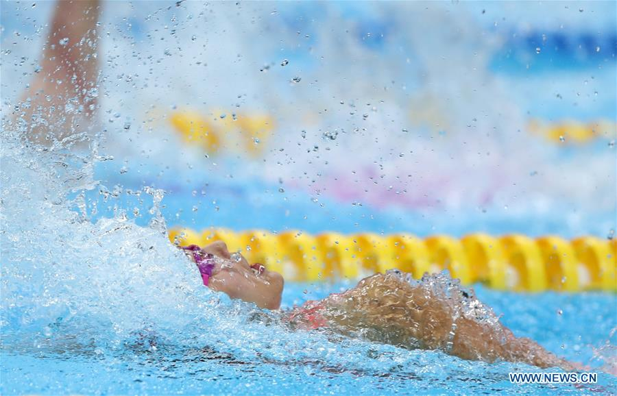 Liu Xiang of China competes during women\'s 50m backstroke final of swimming at the 18th Asian Games in Jakarta, Indonesia, Aug. 21, 2018. Liu won the gold with 26.98 seconds and set a new world record. (Xinhua/Fei Maohua)