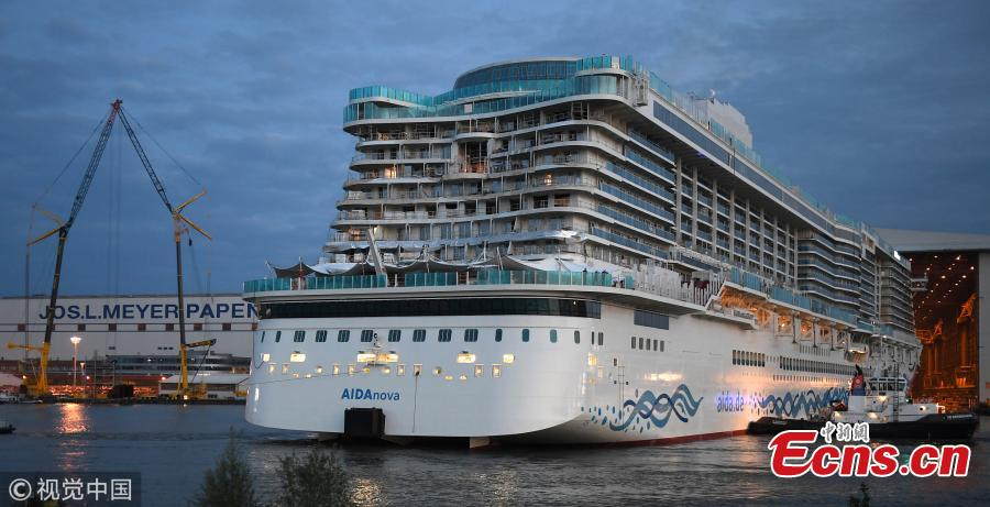 The \'AIDAnova\' cruise ship is towed away from the Meyer Werft shipyards on August 21, 2018 in Papenburg, Germany. The newly-completed 184,000-tonne ship, which is 337 meters long and can accommodate 6,600 passengers, cast and crew. AIDAnova is the World\'s first liquefied natural gas (LNG)-Powered Cruise Ship. (Photo/Agencies)