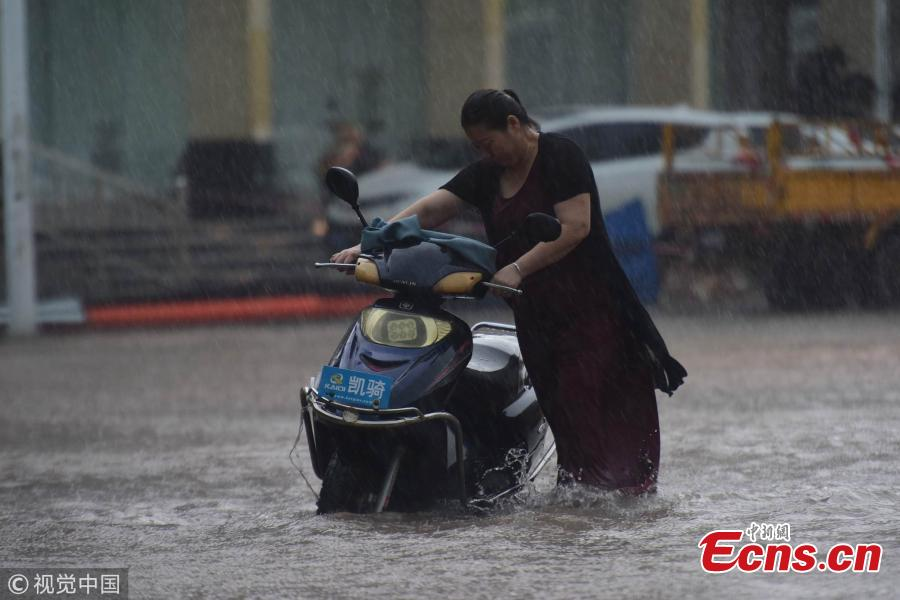 A street floods after a rainstorm in Qionghai City, Hainan Province on Aug. 22, 2018. The local weather bureau issued a warning against thunderstorm and strong winds with it. (Photo/VCG)