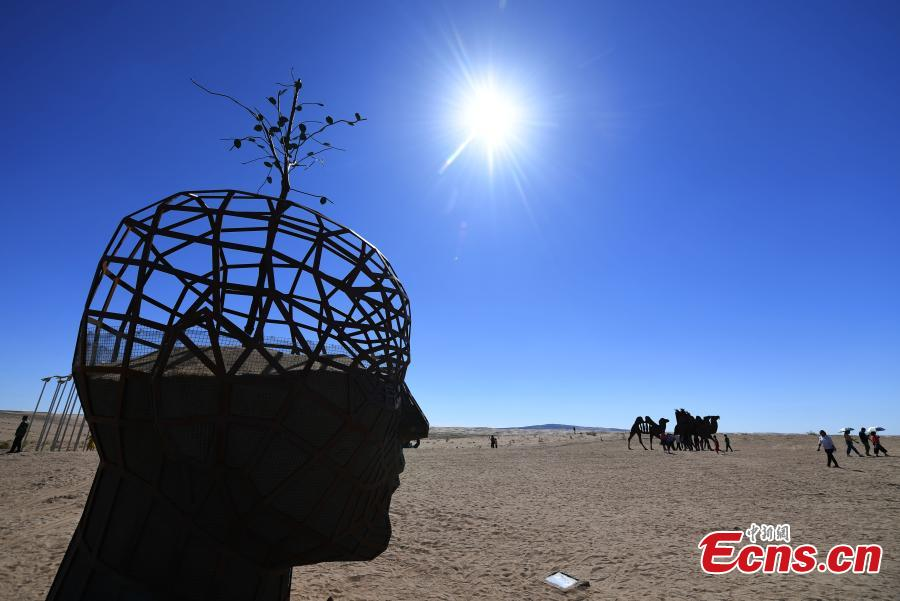 Twenty-six sculptures collected from around the world are on show in a desert in Minqin County, Northwest China's Gansu Province, Aug. 22, 2018. The sculptures have been made from varying materials, including stainless steel, cast iron, stone and cement, and they reveal the ever-present nature of sand and its control in the county. (Photo: China News Service/Yang Yanmin)