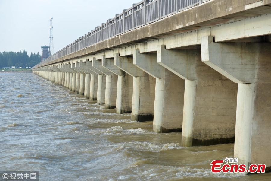 Water level rises in Hongze Lake following recent rainstorms in East China's Jiangsu Province, Aug. 22, 2018. Local authorities said water level of several river channels exceeded alarm line.   (Photo/VCG)