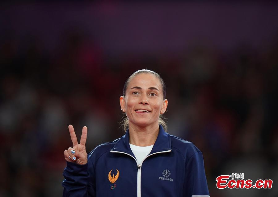 Uzbekistan's Oksana Chusovitina celebrates after winning a silver medal in vault at the Asian Games in Jakarta, Indonesia, Aug.23, 2018. (Photo: China News Service/Hou Yu)