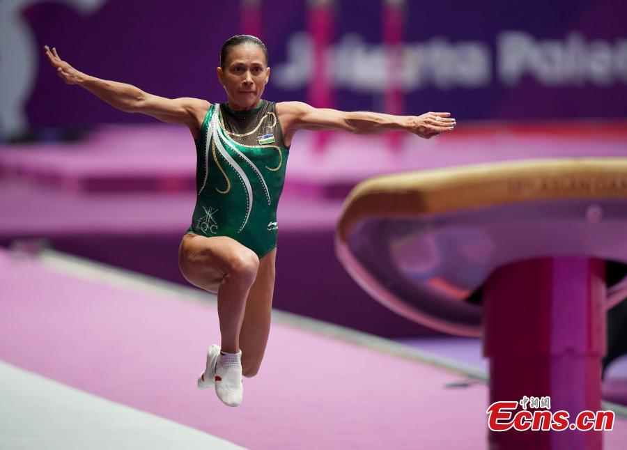 Uzbekistan\'s Oksana Chusovitina performs during the Artistic Gymnastics Women\'s Vault at the 2018 Asian Games in Jakarta, Indonesia, Aug.23, 2018. Chusovitina, 43 years old, won a silver medal in vault at the Asian Games. Chusovitina is a marvel of athletic longevity, with her international gymnastics career spanning nearly 30 years. (Photo: China News Service/Hou Yu)