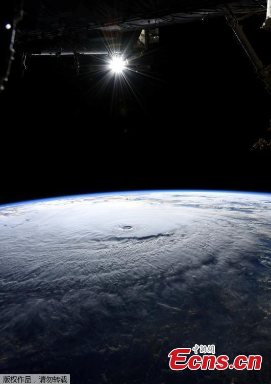 A handout image made available by NASA and taken by an Expedition 56 crew member from the International Space Station shows Hurricane Lane in the Central Pacific Ocean, near Hawaii, Aug. 22, 2018. Hurricane Lane weakened to a Category 3 storm on Thursday but was already lashing Hawaii with high winds and torrential rains, touching off flash floods, landslides and raging surf as residents hunkered down to ride out the storm. (Photo/Agencies)