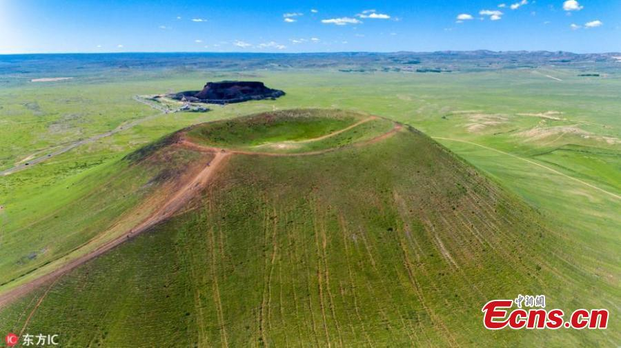 "File photo of Ulan-hada Volcano Geopark in Chahar Right Rear Banner, North China's Inner Mongolia Autonomous Region. The park, 380 kilometers from Beijing and known as a ""museum"" of natural volcanoes and lava landforms, has attracted an increasing number of tourists - at its most, 6,000 a day in 2018 - and local authorities are unable to cope with the strain these numbers place on the management of and environmental protection at the park. The park has recently closed. (Photo/IC)"