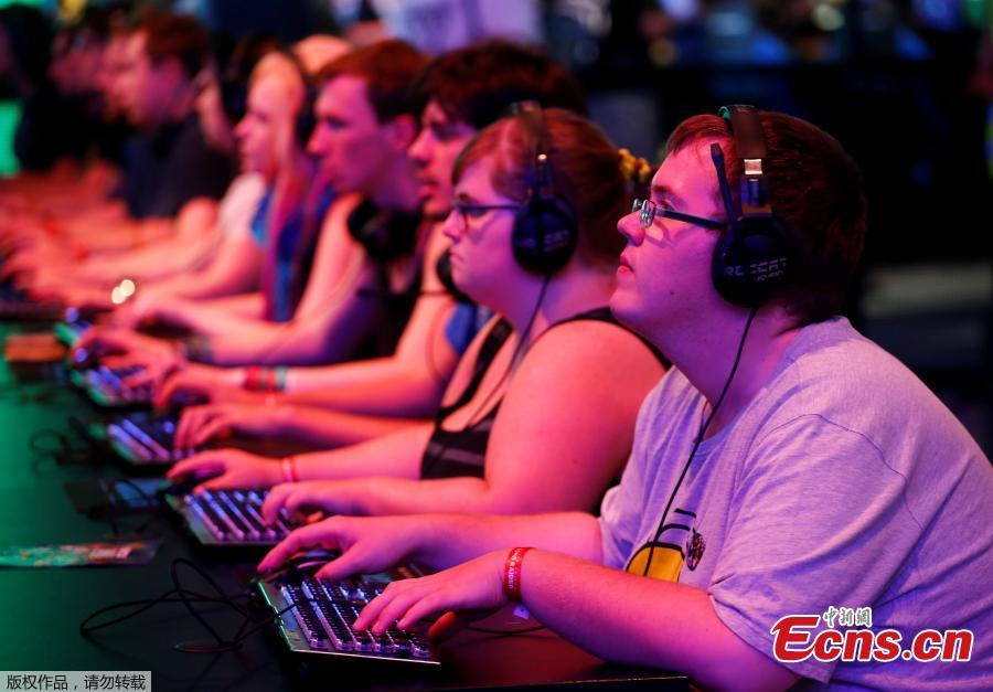 Gamers play during the computer games fair Gamescom in Cologne, Germany, August 22, 2018. (Photo/Agencies)