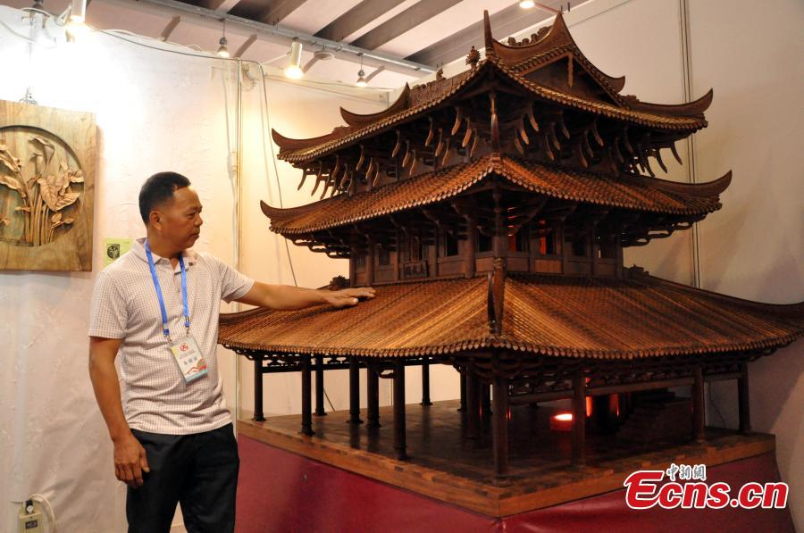 A view of a replica of Zhenwu Pavilion, made with using 3,000 wooden parts by farmer Qin Shikun, during a crafts exhibition in Nanning City, South China's Guangxi Zhuang Autonomous Region, Aug. 24, 2018. It took Qin one and a half years to complete the miniature version of Zhenwu Pavilion, a famous Taoism pavilion for God Zhenwu in Rongxian County of Guangxi, at a scale of 1:10. (Photo: China News Service/Huang Yanmei)