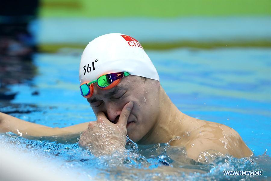 Sun Yang of China reacts after men\'s 1500m freestyle final of swimming at the 18th Asian Games in Jakarta, Indonesia, Aug. 24, 2018. Sun won the gold medal. (Xinhua/Fei Maohua)