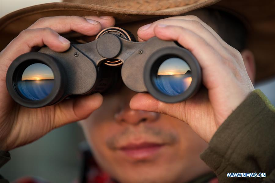 Chinese wildlife conservationist Zhuo Qiang checks the Ol Kinyei conservancy in Maasai Mara, Kenya, July 7, 2018. The founder and Chairman of Mara Conservation Fund (MCF) Zhuo Qiang, a 45-year-old Chinese, has pioneered outstanding wildlife conservation projects in the world famous Maasai Mara ecosystem. Ol Kinyei is among the conservancies benefiting from his activities. Around it, he has built three lion proof boas preventing the wildlife conflict with the adjacent communities. He was officially adopted as a son of the Maasai\'s Ol Kinyei conservation group in 2015, owing to his unwavering friendship with the pastoralists. Zhuo\'s anti-poaching drives in the East African nation expresses the increasing collaboration between Kenyan and China in ending the killing of rhinos, elephants and lions. (Xinhua/Lyu Shuai)