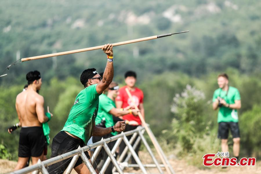 Participants compete in the 2018 Beijing Spartan Trifecta Weekend in Beijing, Aug. 26, 2018. More than 15,000 contestants participated in the obstacle course race that included three events of differing difficulty levels. (Photo: China News Service/Fu Tian)
