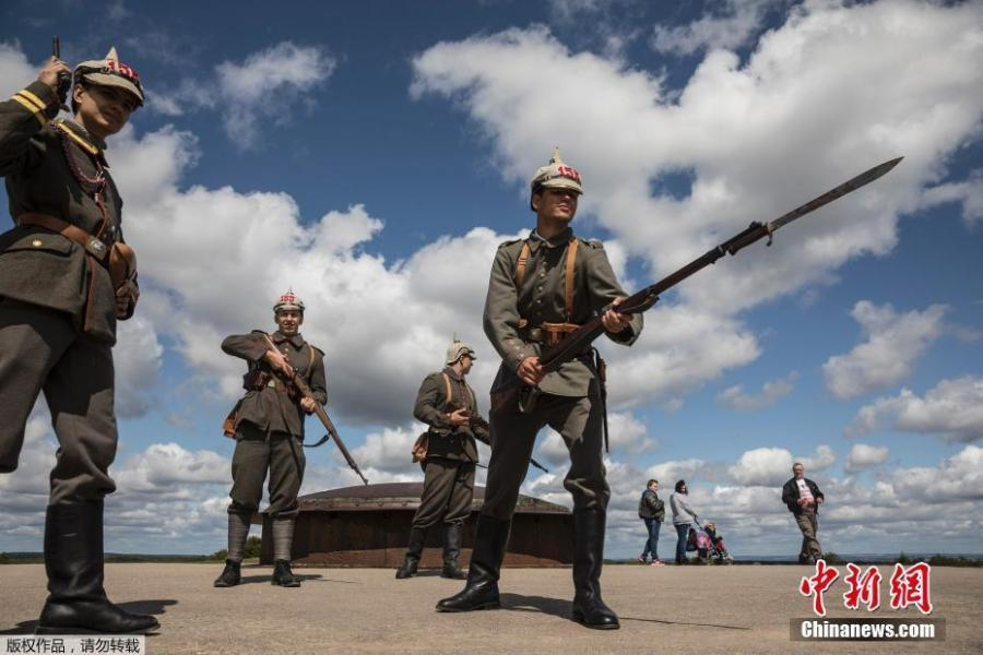 Men dressed in WWI uniforms march during a parade, part of the reconstruction of the WWI battle of Verdun, Aug. 25, 2018, in Verdun, eastern France. Hundreds of volunteers from 18 countries gathered in the French town Verdun as part of a string of events to mark the centenary of the end of World War One, with re-enactors dressed in period soldiers' uniforms bringing to life a big military encampment in the town. (Photo/Agencies)
