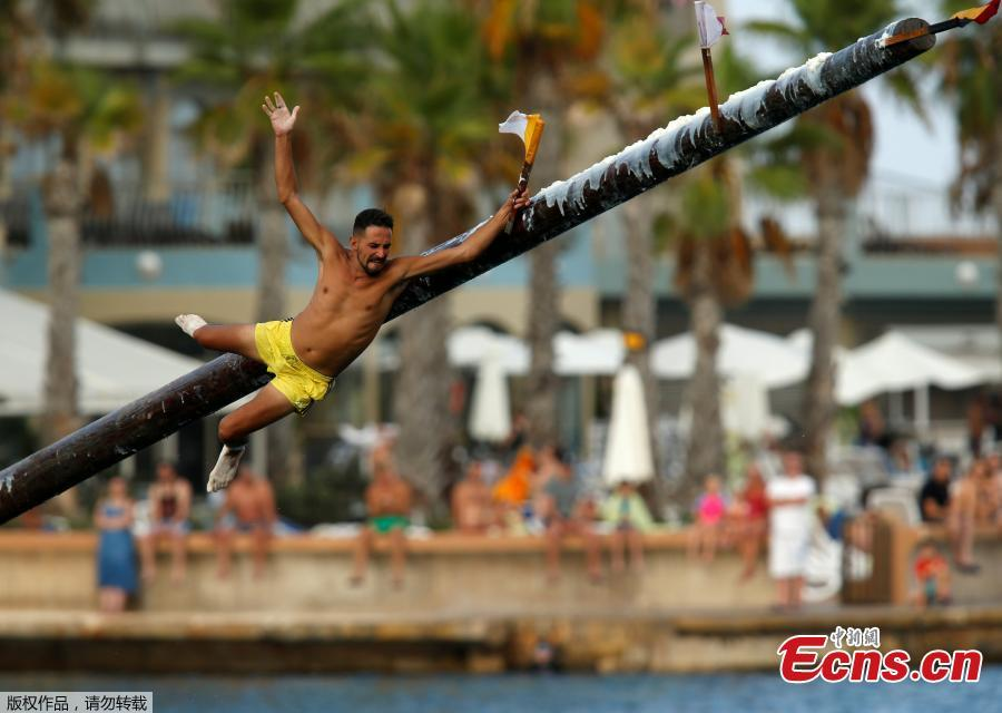 A competitor grabs the final flag as he slips off the \