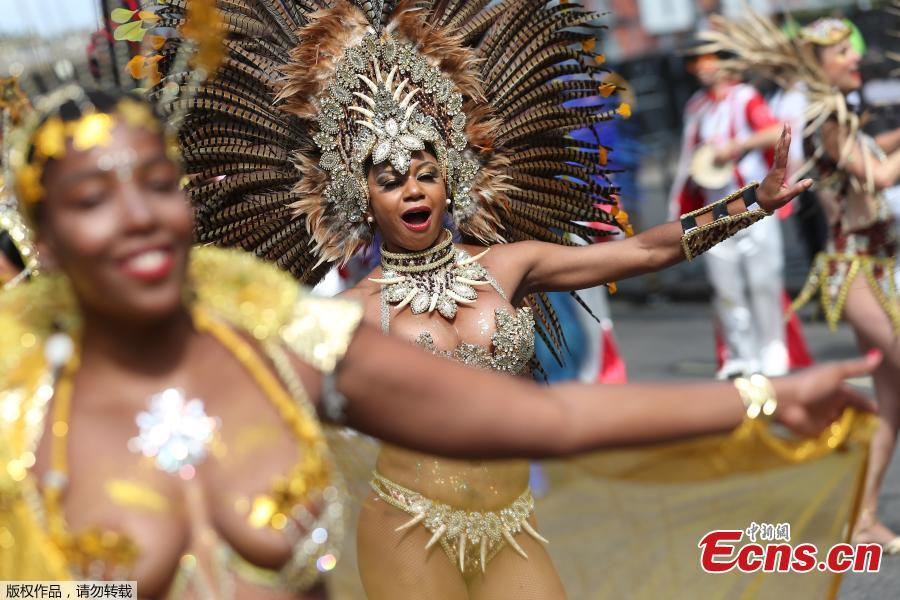 Revelers take part in the Notting Hill Carnival in London, Britain August 27, 2018. The Notting Hill Carnival is a symbol of interracial tolerance which dates back to the 1960s and celebrates the Afro-Caribbean community. (Photo/Agencies)