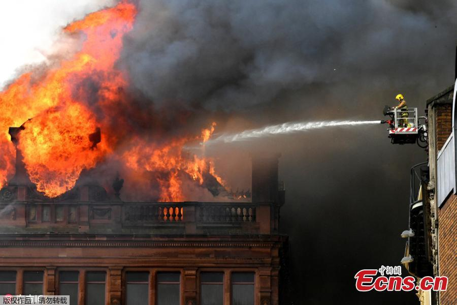 A large blaze engulfs the roof of a landmark building undergoing refurbishment in Belfast, the Northern Ireland capital, Aug. 28, 2018. The Northern Ireland Fire and Rescue Service says it was called Tuesday morning to a blaze at the Bank Buildings, home to clothing retailer Primark. Flames engulfed the roof of the structure, destroying the rooftop clock, before spreading through the five-story building. The Bank Buildings date from the late 18th century, though the current structure was built around 1900. It was nearing the end of a major renovation. (Photo/Agencies)