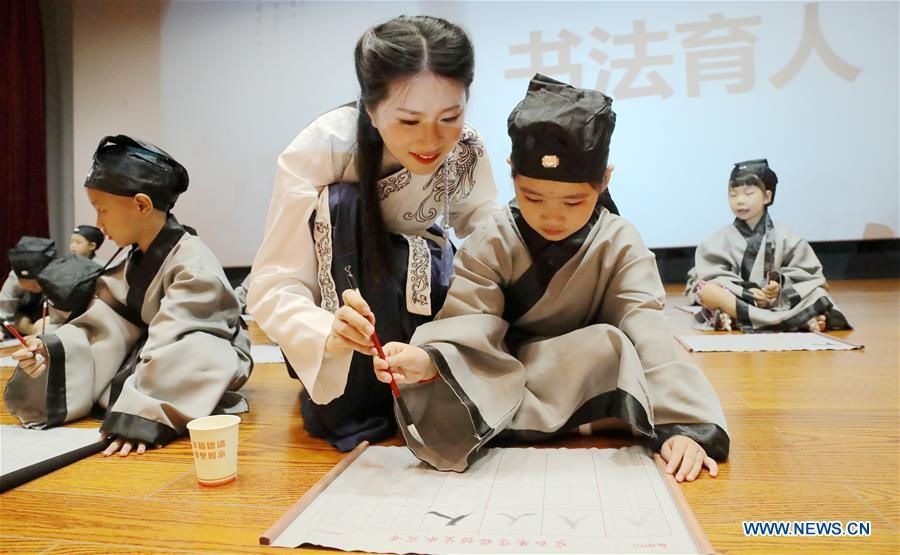 A newly-enrolled pupil learns to write a Chinese character \