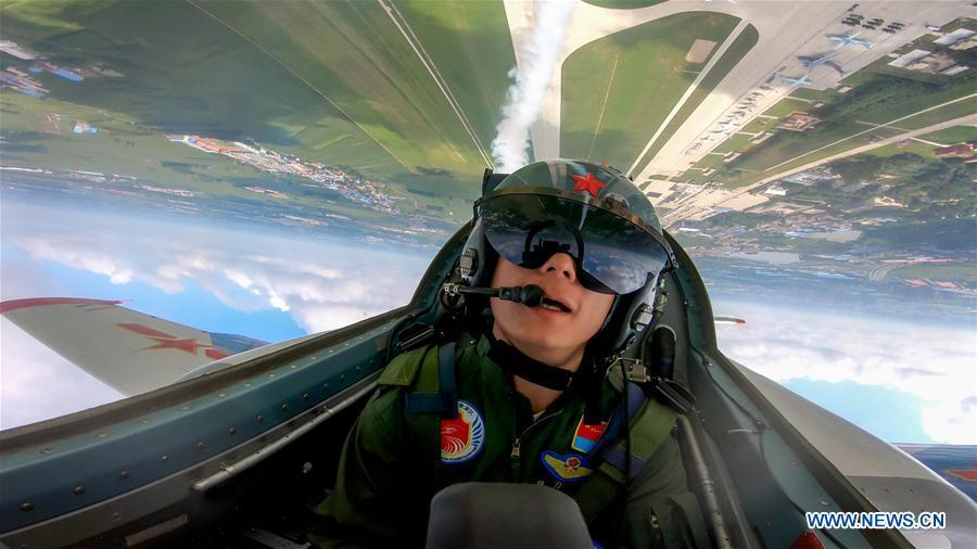 A pilot of Red Falcon Air Demonstration Team performs during an activity of opening day at the Aviation University of Air Forces in Changchun, capital of northeast China\'s Jilin Province, Aug. 30, 2018. (Xinhua/Yang Pan)