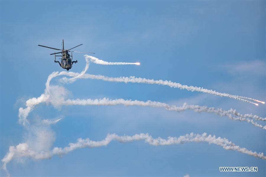 A helicopter performs during an activity of opening day at the Aviation University of Air Forces in Changchun, capital of northeast China\'s Jilin Province, Aug. 30, 2018. (Xinhua/Yang Pan)