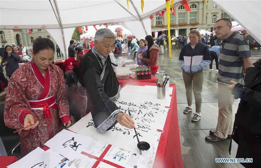 People write Chinese calligraphy during the \