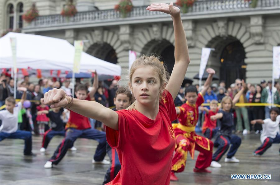 Local teenagers perform Chinese martial arts during the \