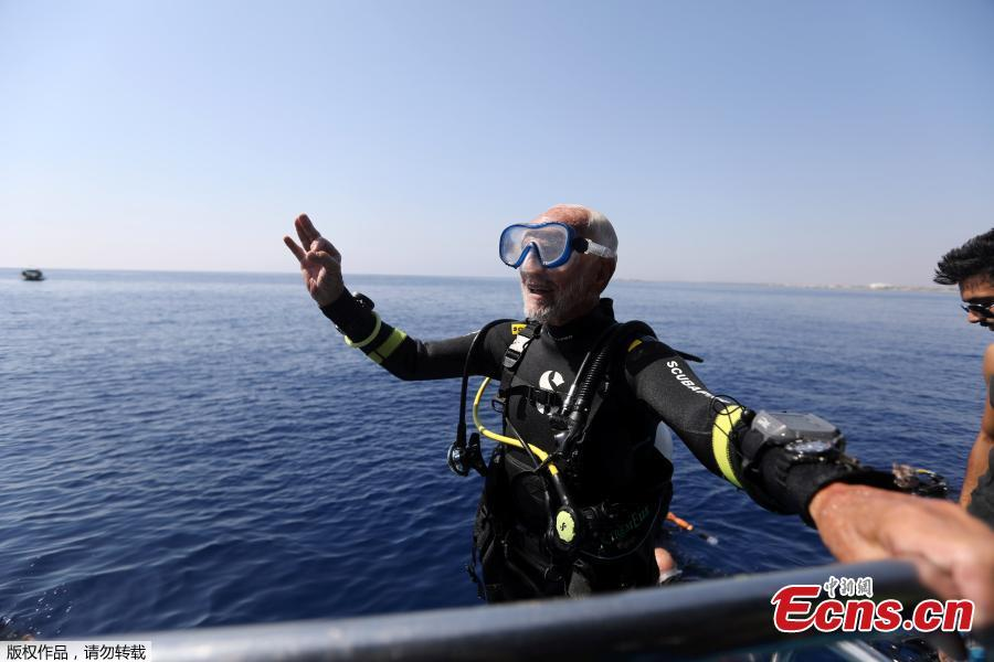 Ray Woolley, pioneer diver and World War 2 veteran, gestures after breaking a new diving record as he turns 95 by taking the plunge at the Zenobia, a cargo ship wreck off the Cypriot town of Larnaca, Cyprus September 1, 2018. (Photo/Agencies)