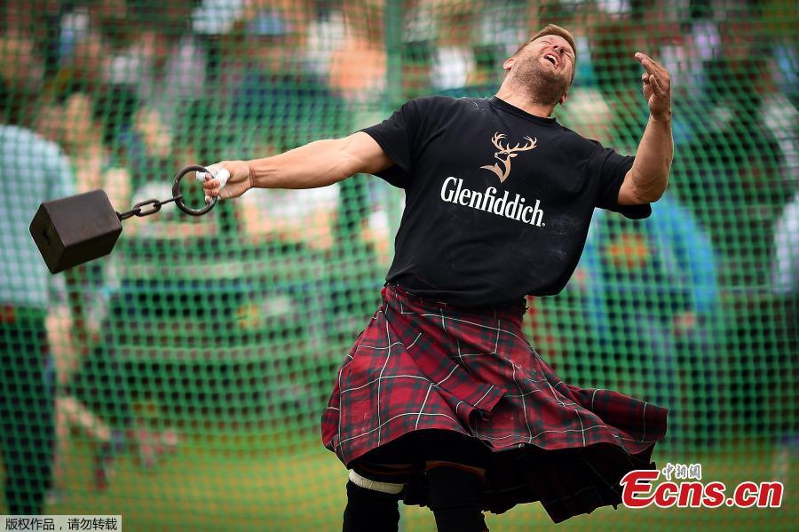 A competitor throws a hammer as he participates at the annual Braemar Highland Gathering in Braemar, Scotland, Britain, Sept. 1, 2018. The gathering is seen as the biggest in the Highland Games calendar and is known worldwide. (Photo/Agencies)