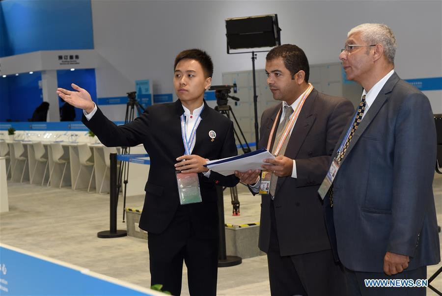 Guo Xu (1st L), a volunteer from Beijing University of Posts and Telecommunications, introduces to two Egyptian journalists about the media center for the Beijing Summit of the Forum on China-Africa Cooperation (FOCAC) in Beijing, capital of China, Sept. 3, 2018. The FOCAC Beijing Summit involves some 2,500 volunteers, most of whom are students from 32 higher education institutions. The volunteers are mainly responsible for tasks in venue services, guest reception, registration, media services and transportation. (Xinhua/Luo Xiaoguang)