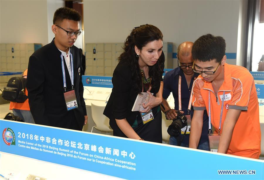 Tian Yu (1st L), a volunteer from Beijing University of Posts and Telecommunications, provides language service to journalists from Cuba at the media center for the Beijing Summit of the Forum on China-Africa Cooperation (FOCAC) in Beijing, capital of China, Sept. 3, 2018. The FOCAC Beijing Summit involves some 2,500 volunteers, most of whom are students from 32 higher education institutions. The volunteers are mainly responsible for tasks in venue services, guest reception, registration, media services and transportation. (Xinhua/Luo Xiaoguang)