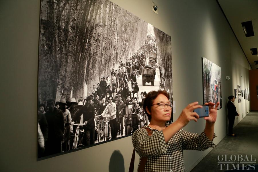 "A photo exhibition called ""Photographs at China: 40 Years through the Lens"" kicked off at the National Museum of China in Beijing on August 30 to mark the 40th anniversary of China's reform and opening-up. The exhibition will be open until September 12. (Photos: Li Hao/GT)"