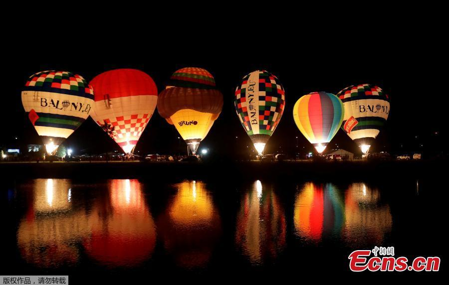Balloons are lit by their gas burners during the Czech Hot Air Balloon Championship near the town of Uherske Hradiste, Czech Republic, Aug. 31, 2018. (Photo/Agencies)