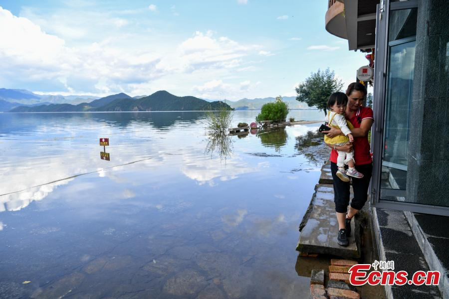 Water overflows the shores of Lugu Lake, a tourist attraction in Ninglang Yi Autonomous County, Southwest China's Yunnan Province, Sept. 2, 2018. Local authorities have increased efforts to release more water from the lake following days of heavy rain. (Photo: China News Service/Ren Dong)