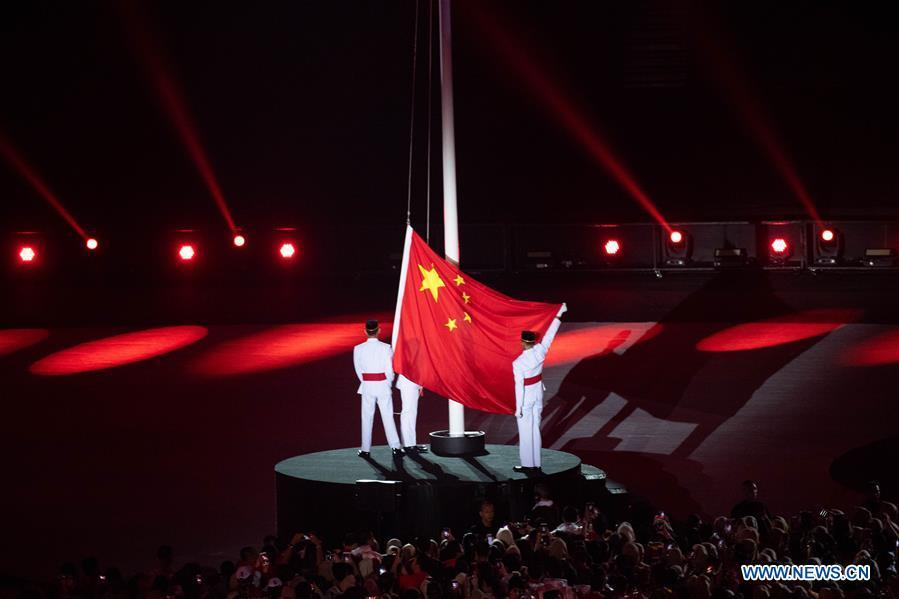 The national flag of China is raised during the closing ceremony of the 18th Asian Games at the Gelora Bung Karno (GBK) Main Stadium in Jakarta, Indonesia, Sept. 2, 2018.(Xinhua/Cheong Kam Ka)