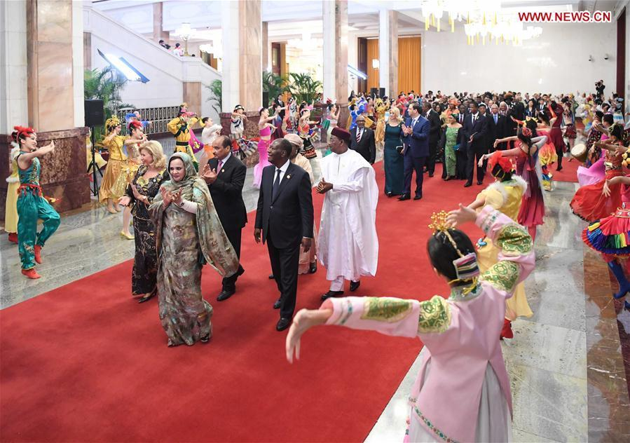 Foreign leaders and their spouses attending the Beijing Summit of the Forum on China-Africa Cooperation (FOCAC) are greeted by young performers on their way to a welcoming banquet held by Chinese President Xi Jinping and his wife Peng Liyuan at the Great Hall of the People in Beijing, capital of China, Sept. 3, 2018. (Xinhua/Shen Hong)