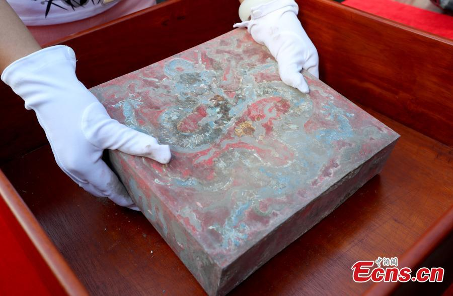 After preparing for two years, the research project into the restoration and conservation of The Hall of Mental Cultivation was launched on September 3, 2018 at the Palace Museum. Preparations began in December 2015, when collections inside the hall were labeled, recorded, restored and studied. The restoration work will cover 7,707 square meters, including 13 ancient buildings along with the doors and screen wall.  (Photo: China News Service/Zhang Yu)