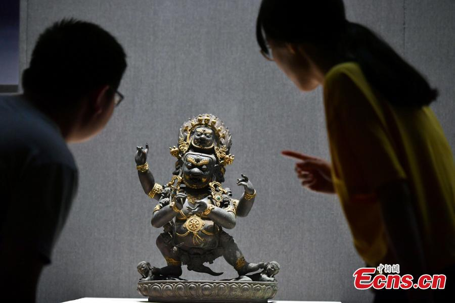 An exhibition of bronze Buddha statues opens in Shijiazhuang City, North China's Hebei Province, Sept. 4, 2018. Hebei Provincial Museum displayed some 200 selected bronze Buddha statues made in the period from the Sixteen Kingdoms in the north (303?439) to the Qing Dynasty (1368-1644) to show the evolution of Buddhism and Buddha images in China. (Photo: China News Service/Zhai Yujia)