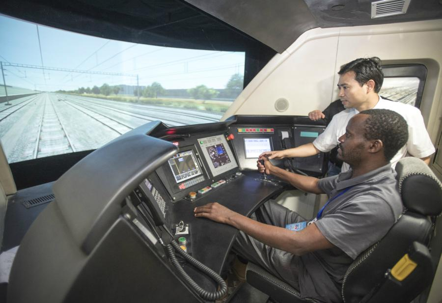 A Kenyan railway executive gets on the fast track in a state-of-the-art train simulator in Wuhan, Hubei Province, in June.  (Photo/Xinhua)