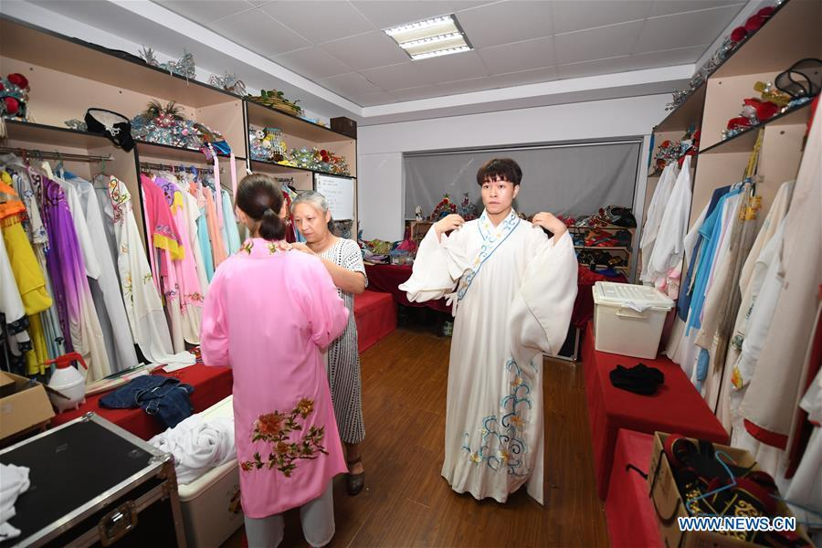 Wang Hongyuan (R) changes clothes before performing at Shengzhou Yue Opera art school in Shengzhou, east China\'s Zhejiang Province, Sept. 3, 2018. Wang Hongyuan, 17, was born in Taizhou of Zhejiang Province. He is the only male student who learns playing Xiaosheng (role of young man) in Yue Opera at Shengzhou Yue Opera art school. Xiaosheng are usually played by female actresses in Yue Opera which is an old art form originated in Shengzhou and noted for its lyricism and sweet tunes in China. Wang Hongyuan was granted special admission on account of his talent and resolve when he was at second grade in junior middle school. After hard practices, he has already taken part in some performances. (Xinhua/Weng Xinyang)