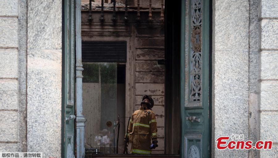 A firefighter inspects the burnt National Museum in Rio de Janeiro, Brazil, on September 4, 2018 two days after a massive fire ripped through the building.