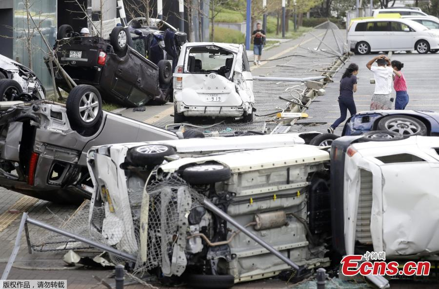 Vehicles damaged by Typhoon Jebi are seen in Osaka, western Japan,?in this photo taken by Kyodo September 4, 2018.(Photo/Agencies)