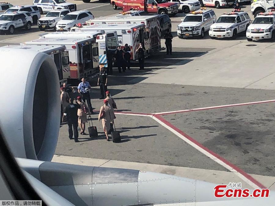 Air cabin crew members and the emergency services are seen leaving the plane, after the passengers were taken ill on a flight from New York to Dubai, on JFK Airport, New York, U.S., September 05, 2018 in this still image obtained from social media.(Photo/Agencies)