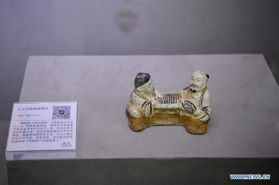 An exhibit depicting people playing Go is displayed at Go (Weiqi) museum in Luoyang, central China\'s Henan Province, Sept. 5, 2018. The private museum displays about 25,000 exhibits relating to Go game in China. (Xinhua/Feng Dapeng)