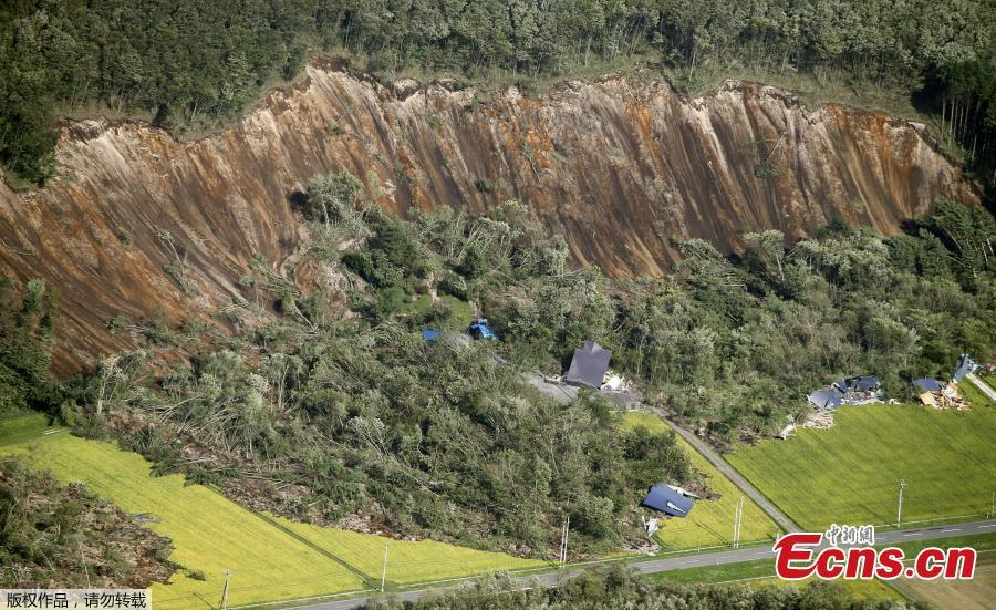 Houses damaged by a landslide caused by an earthquake, are seen in Atsuma town in Japan\'s northern island of Hokkaido, Japan, in this photo taken by Kyodo September 6, 2018. (Photo/Agencies)