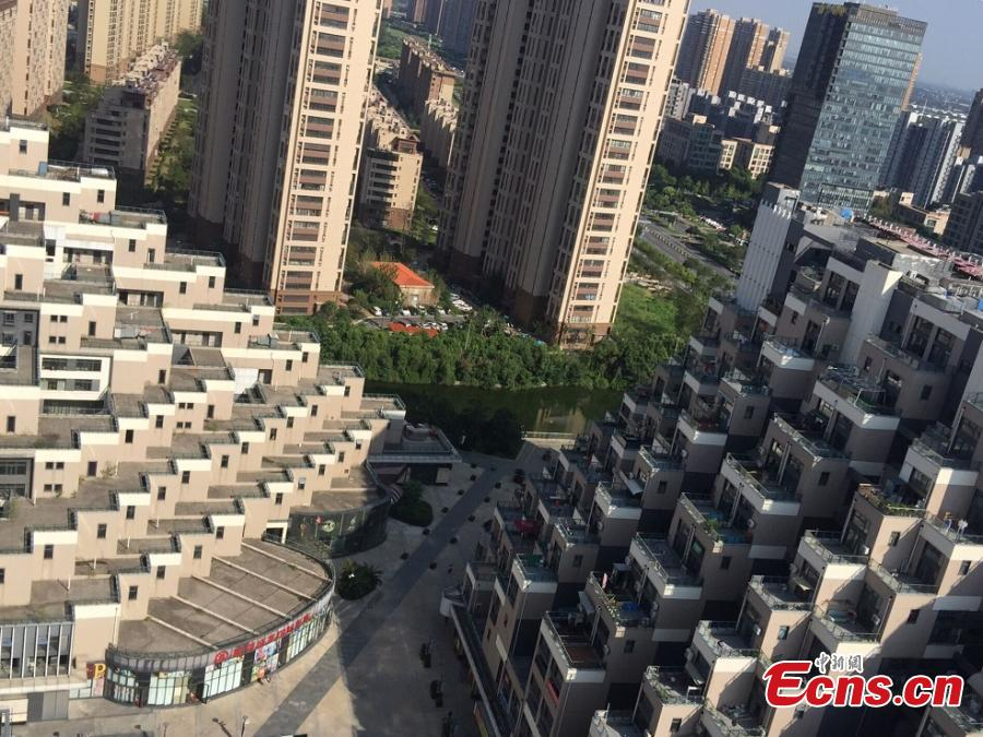 A building complex that looks like a pyramid in Kunshan City, East China's Jiangsu Province, Sept. 5, 2018. Pictures of the complex, comprised of three buildings located on a mountain, went viral on the Internet due to its unique architectural appearance. The complex was put into use in 2013 and has a total floor area of 130,000 square meters. (Photo: China News Service/Huang Ying)