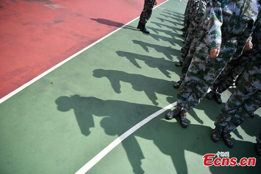 Freshman students from the Yunnan Arts University pose for photos during a compulsory military training in Kunming City, Southwest China's Yunnan Province, Sept. 6, 2018. Military training, compulsory for freshmen in China\'s colleges, includes a diverse range of programs. (Photo: China News Service/Liu Ranyang)