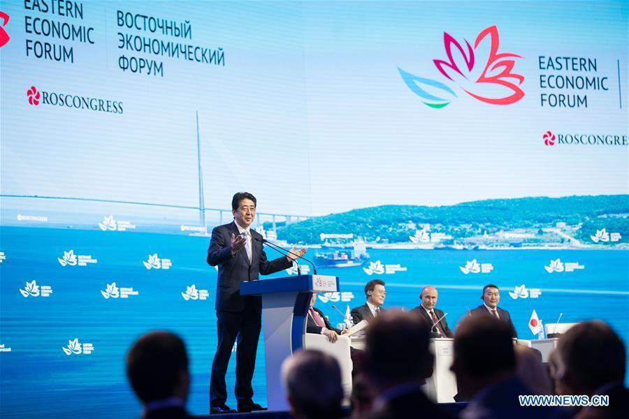 Japanese Prime Minister Shinzo Abe (L) speaks on the plenary session of the third Eastern Economic Forum in Vladivostok, Russia, on Sept. 7, 2017. (Xinhua/Wu Zhuang)