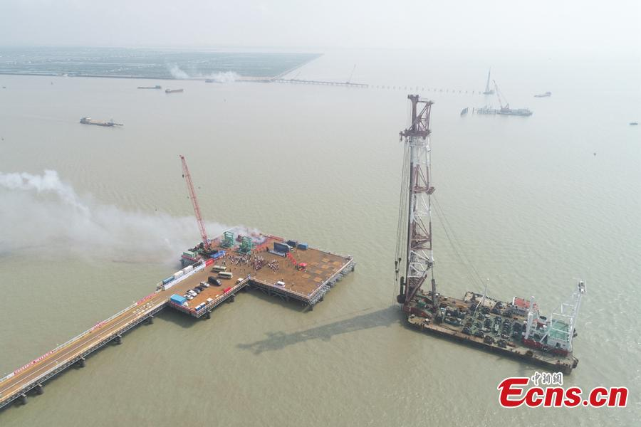 Construction begins on the main piers of the Lingdingyang Bridge, one part of the massive Shenzhen-Zhongshan Expressway, on Sept. 6. The 24-kilometer-long Shenzhen-Zhongshan Expressway consists of a series of bridges and tunnels and links two major cities on the Pearl River Delta-Shenzhen and Zhongshan. Lingdingyang Bridge is reported to be the highest cross-sea bridge and with the longest span in the world. The work on the piers will be completed by September 2020. (Photo: China News Service/Yue Lujian)